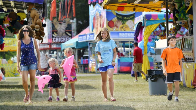 Courtney Backes, from left: her children, Aubree and Macey, and family friends Katelyn Zimmer and Koye Zellner, take in the sights of the Stearns County Fair on Aug. 1, 2014, in Sauk Centre.
