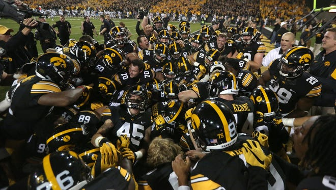 Iowa celebrates its 27-24 victory over Pittsburgh, a win that moved the Hawkeyes to 3-0 for the first time since 2009.
