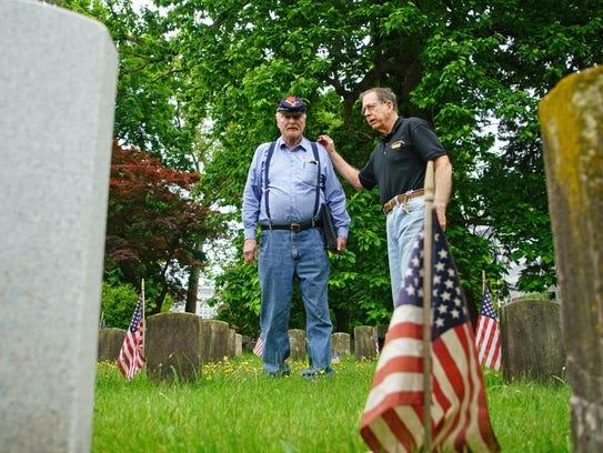 Vietnam veteran Ken Finlayson (right) speaks to Don