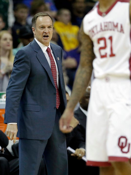 Oklahoma coach Lon Kruger instructs his players during the second half of an NCAA college basketball game against Baylor in the Big 12 men's tournament on Thursday, March 13, 2014, in Kansas City, Mo. Baylor won the game 78-73. (AP Photo/Charlie Riedel)