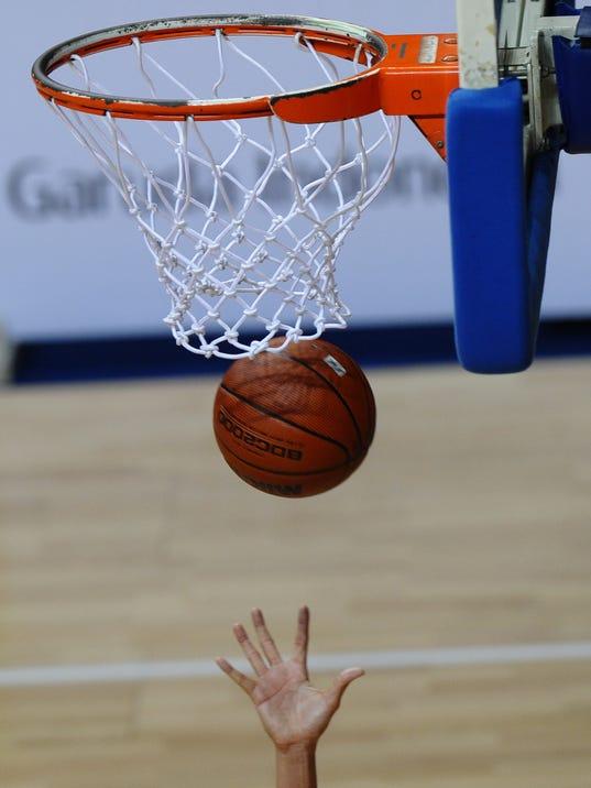 The ball falls through the net as a Mala