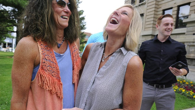Married couple Dawn Chapel, left, and Lee Chaney, right share a laugh after they were married together by  Ingham County Clerk Barb Byrum in Mason on Friday morning soon after the US Supreme Court ruling striking down Michigan's ban on same-sex marriage. At right is Lee Chaney's son Josh Rudd.