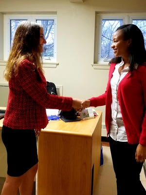 Alyssa D'Alessandro (left) greets her interviewer, Brittany Himes, with a firm handshake during Our Lady of Mercy Academy's Mock Interview Day.