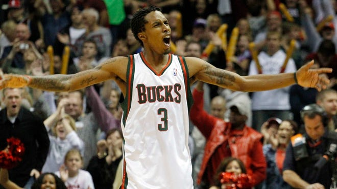 Milwaukee Bucks' Brandon Jennings reacts at the end of the game against the Golden State Warriors in an NBA basketball game Saturday, Nov. 14, 2009, in Milwaukee. Jennings scored 55 points in the Bucks victory over the Warriors 129-125. (AP Photo/Jeffrey Phelps)