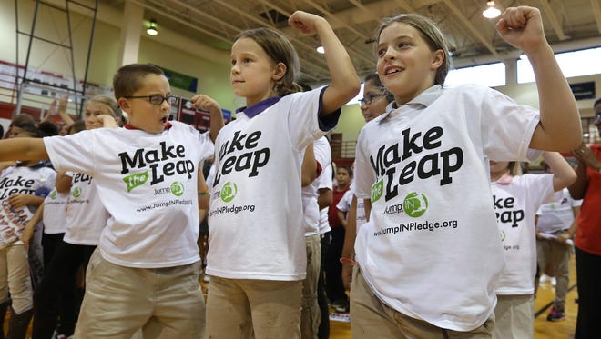"Kids do the Tan-Za-Mania dance called ""Jump IN"" during the Jump IN for Healthy Kids event on Sept. 2, 2015, at the University of Indianapolis. The event was to launch a campaign to reduce childhood obesity in Central Indiana by 12 percent by 2025."