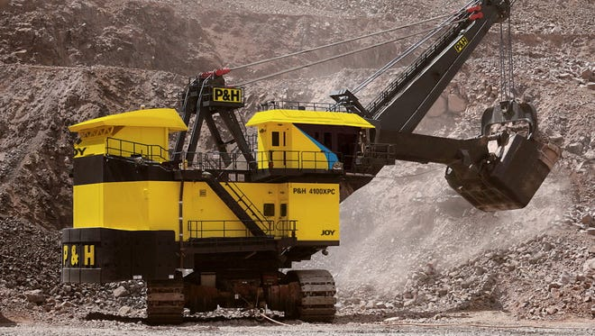 A P&H mining shovel, made by Joy Global Inc., works in the oil sands region of Canada. Joy Global is being renamed Komatsu Mining Corp.