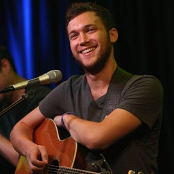 """""""American Idol"""" season 11 winner Phillip Phillips performs at the Q102 Performannce Theater Aug. 23, 2013, in Bala Cynwyd, Penn."""