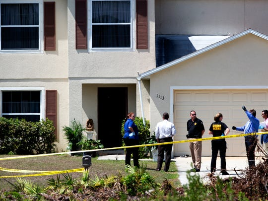 Members of the Lee County Sheriff's Office investigate the scene of a home invasion involving a death on Plumosa Ave. in Lehigh Acres on Monday 3/16/2015. Hemchand Bhagwandin, 68 was killed.