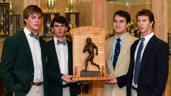 Asheville School and Christ School captains pose with the Fayssoux-Arbogast trophy earlier this week.
