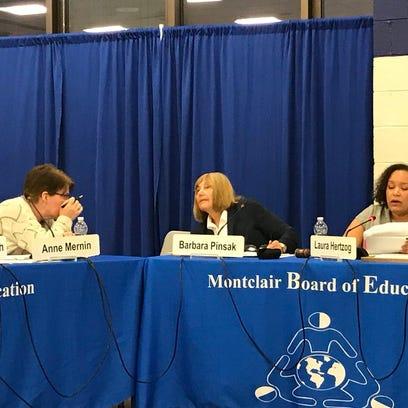 Montclair BOE President Laura Hertzog, left, announces