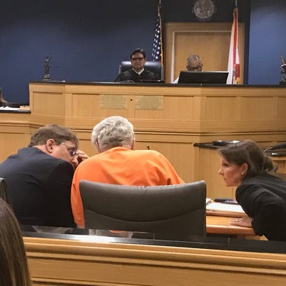 Defense lawyers chat with  James Morgan as his murder
