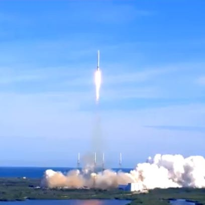 A SpaceX Falcon 9 rocket and Dragon cargo capsule blasted