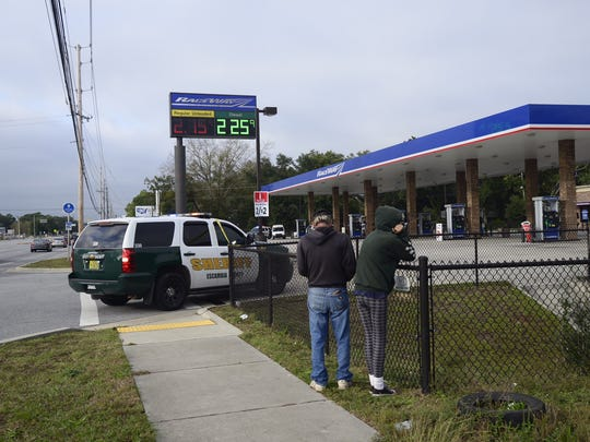 Two people were shot and killed at a gas station in Pensacola on Tuesday.