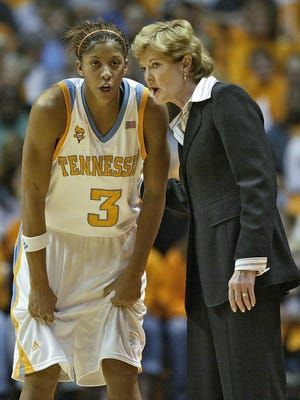 Tennessee coach Pat Summitt, right, talks with Candace Parker during a game against Stanford on Nov. 24, 2006, in Knoxville.