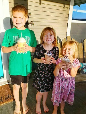 Haviland children of Justin and Shelbey Kendall enjoy treats from Origins Coffeehouse at their home, courtesy of free to-go and delivery service now available to customers in the local area.
