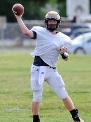 Abilene High quarterback Eric Abbe sets to throw during the Eagles' first spring football practice on April 30, he is one of two players vying for the Eagles starting Quarterback position.
