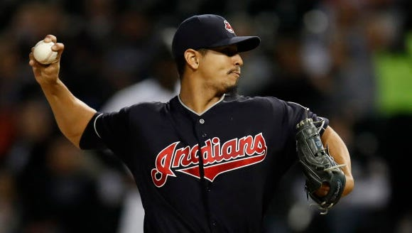 Carlos Carrasco threw a complete game as the Indians won a 14th consecutive game.