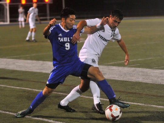 Paul VI's Ji Park (9) and St. Augustine's Sam Mitcho (16) battle for possession during Tuesday's sectional semifinal.