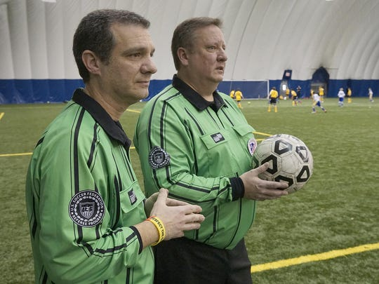 On any given Saturday, Mario D'Agostino (left) and Kevin Winningham expect to work several games, at the very least. Every year, fewer are returning to officiate contests in youth, high school and adult rec leagues.