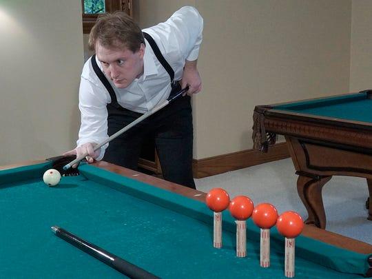 "William ""The Gentleman"" DeYonker begins his trick shot"
