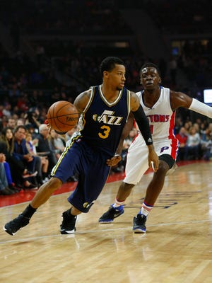 Utah Jazz guard Trey Burke (3) drives on Detroit Pistons guard Reggie Jackson (1) in the first half of an NBA basketball game Wednesday, Oct. 28, 2015 in Auburn Hills, Mich.