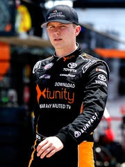 Matt Tifft, driver of the No. 19 Toyota, walks through the garage area during practice for the NASCAR XFINITY Series Coca-Cola Firecracker 250 at Daytona International Speedway on June 29, 2017 in Daytona Beach.