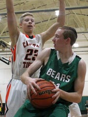 Lathan Green tries to get pass off while being guarded by Capitan's Stephen Eliison on Friday night.