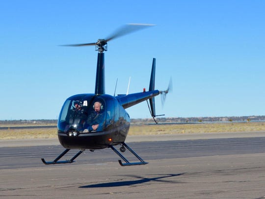 Millionaire Forrest Fenn, right in a hired helicopter, takes off from Santa Fe airport in search of treasure hunter Randy Bilyeu on Jan. 26.