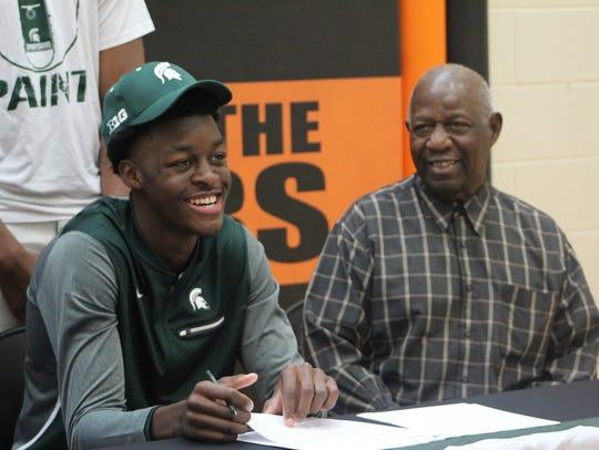 Belleville High School senior Gabe Brown signs his