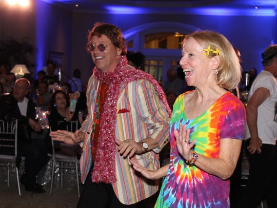 Jim and Nan Henderson boogie '70's style at the annual