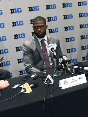 Ohio State Buckeyes quarterback J.T. Barrett addresses the media during the Big Ten football media day at  the Hyatt Regency.