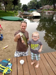 David and Jackson Lyons show off their catch after