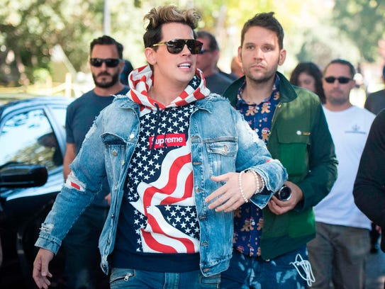 Conservative commentator Milo Yiannopoulos is escorted