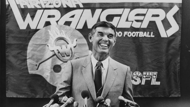 """Dr. Edward """"Ted"""" Diethrich, heart surgeon, at an Arizona Wranglers football press conference."""