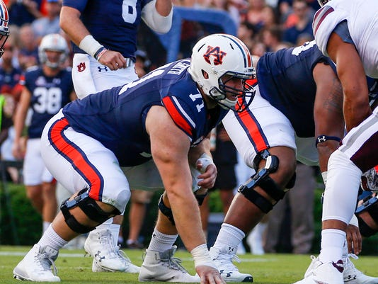 FILE - This Sept. 30, 2017, file photo shows Auburn offensive lineman Braden Smith (71) lining up against Mississippi State during the first half of an NCAA college football game in Auburn, Ala. Auburn's offensive line is one of the best in college football, named a semifinalist for the Joe Moore Award that goes to the nation's best line. Smith is the leader. (AP Photo/Butch Dill, File)