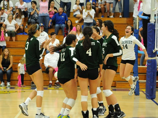 The Seacrest Country Day volleyball team celebrates after beating Lake Worth Christian, 3-1, in the Class 3A state semifinals on Saturday, Nov. 5, 2016 in Lake Worth.