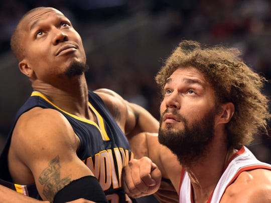 Pacers forward David West (21) and Blazers center Robin Lopez (42) battle for position at the Moda Center at the Rose Quarter.