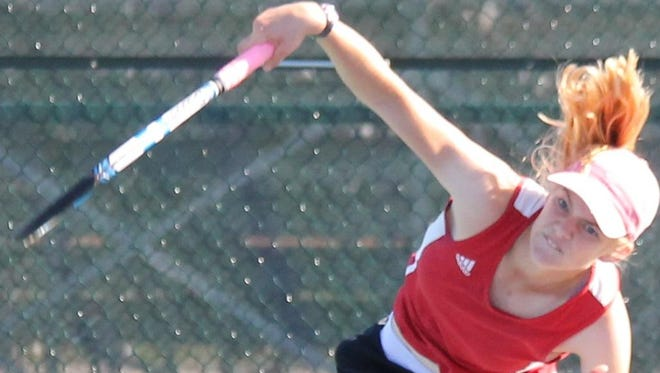 Milford's Amanda Reinhart serves in her match against Walnut Hills' Lilly O'Toole Sept. 15.