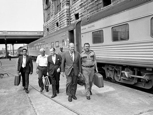 Five Metro Council members leave Amtrak's Chicago-Florida passenger train after arriving in Nashville from Louisville, Ky., on an inspection trip Aug. 29, 1973. Councilmen Jimmy Hawkins, left, Elzie C. Jones, Tom McGrath, Tom Sharp and Fred Lowry made the trip to inspect the equipment, interview passengers and determine a better method of providing services for Amtrak users. The train was almost four hours late when one of the four engines caught fire.
