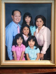 A photo of Audie Trinidad, his wife Mary Rose and their daughters Danna, Kaitlyn, Allison and Melissa.