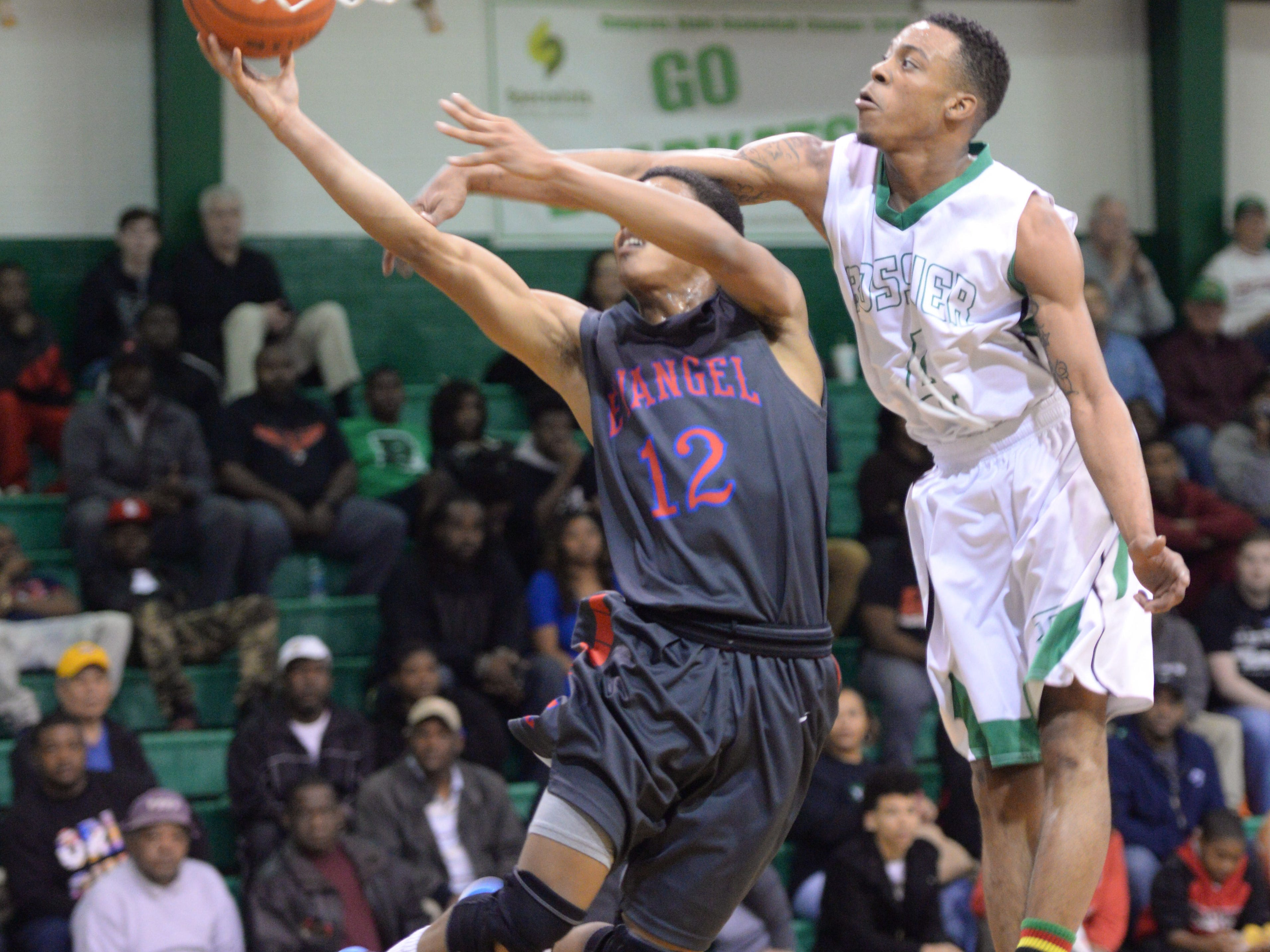 Bossier's Kentrell Hardy fouls Tim Stokes of Evenagel during Bossier's 54-37 win Tuesday night.