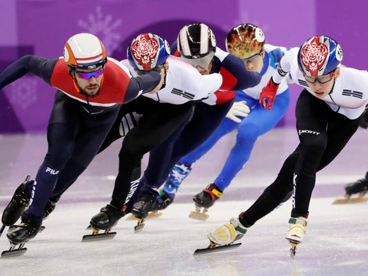 Lim Hyojun, right, of South Korea leads Sjinkie Knegt of the Netherlands on his way to winning the men's 1500 meters short-track speedskating final in the Gangneung Ice Arena at the 2018 Winter Olympics in Gangneung, South Korea, Saturday, Feb. 10, 2018. (AP Photo/Julie Jacobson)