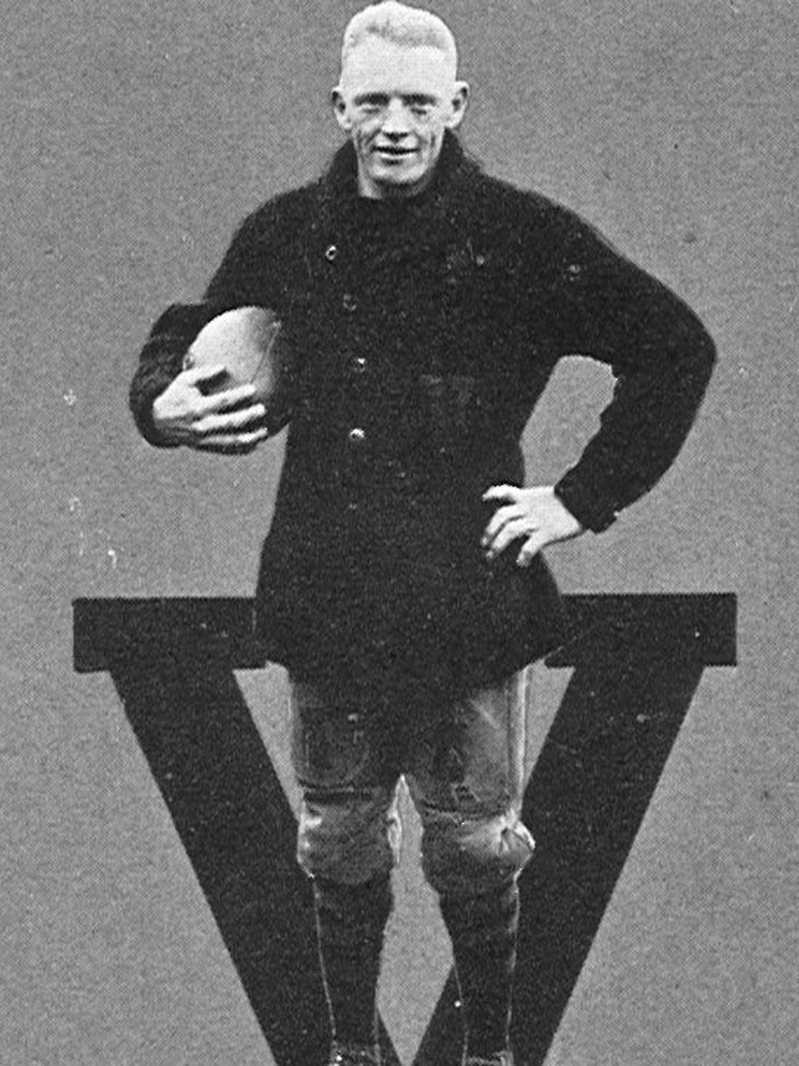 "Johnny ""Red"" Floyd poses for his senior football photo"