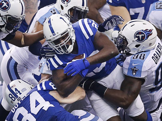 Indianapolis Colts running back Frank Gore (23) pushes his way through the Tennessee Titans defensive line at Lucas Oil Stadium on Jan. 3, 2016.