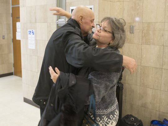 Glenn Olvey (left), hugs fellow Richmond Hill neighbor Roz Aldridge, after the sentencing of Monserrate Shirley, who was sentenced to 50 years in prison on Dec. 20 2016, for her role in the 2012 Richmond Hill explosion,.