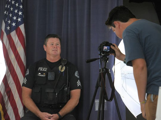 Ventura Police Sgt. and Navy veteran Jerry Foreman has his picture taken by Pacific High School student Adam Lough-Laurence for the school's Voices for Veterans project.
