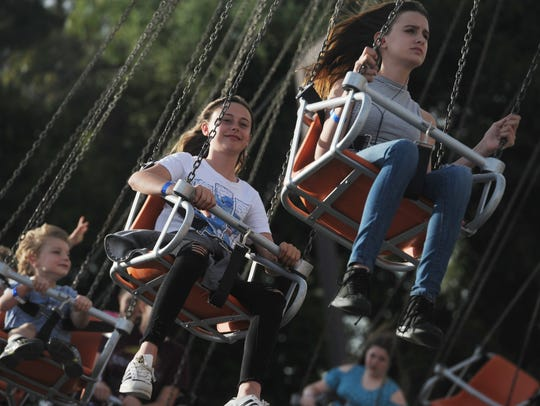 Visitors enjoy a ride during a past Conejo Valley Days festival.