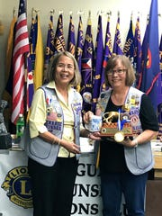 Guam Sunshine Lions Club member Jill Pangelinan, right, was recognized for her service as LCI District 204 Region I Zone 3 Chairperson during Lion Year 2016-2017, at the District's 25th Anniversary and Installation of Officers at the Sheraton Laguna Resort on Oct. 8.  President Rosie Matsunaga, presented the tokens of appreciation during the club's general membership meeting Oct. 17.