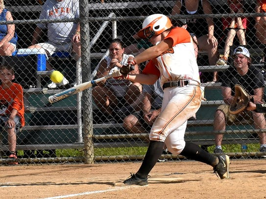 Maclai Branson of Ryle drives a home run to add to