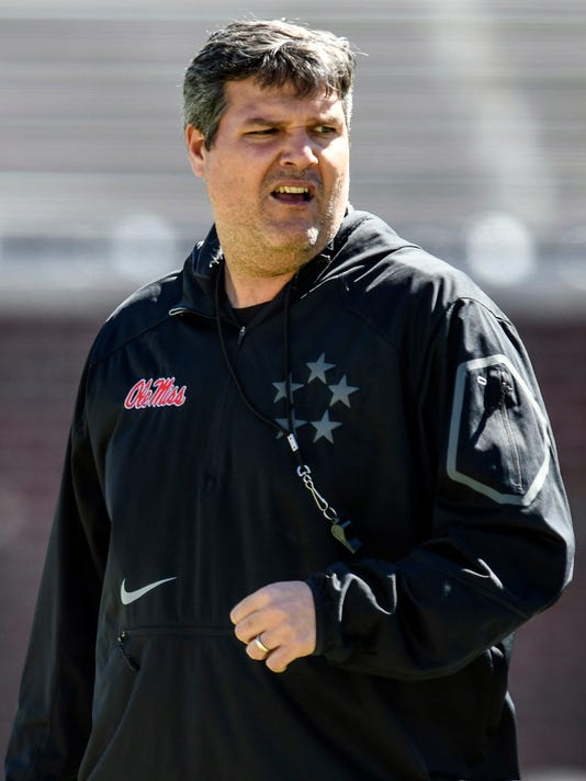 Mississippi head coach Matt Luke watches during spring NCAA college football practice at Vaught-Hemingway Stadium in Oxford, Miss., Saturday, March 3, 2018. (Bruce Newman/The Oxford Eagle via AP)